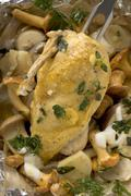 Chicken breast with mushrooms and herbs in aluminium foil Stock Photos
