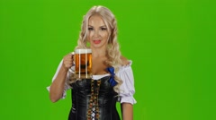 Bavarian girl with beer showing thumbs up. Green screen Stock Footage
