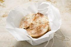Caramelised aniseed biscuits in paper (Spain) Stock Photos