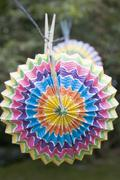 Coloured Chinese lanterns on washing line (garden party decorations) Stock Photos