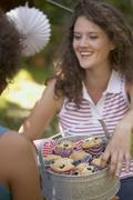 Young women with blueberry muffins on the 4th of July (USA) Stock Photos