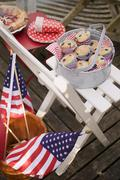 Blueberry muffins on a garden chair, 4th of July (USA) Stock Photos