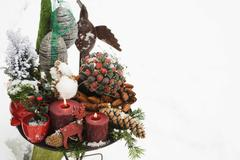 Christmas decorations on table out of doors Stock Photos