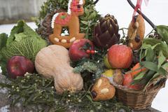 Gingerbread, fruit, vegetables and mistletoe Stock Photos