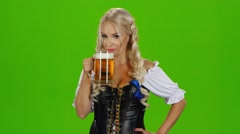 Women in traditional bavarian tracht drinking beer and showing thumbs up. Green Stock Footage