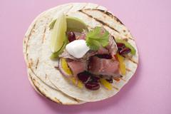 Beef fajita with beans, peppers and sour cream Stock Photos