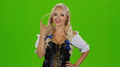Sexy bavarian girl playing with her hair. Green screen Stock Footage