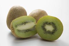 Kiwi fruits, whole and halved (lengthwise and crosswise) Stock Photos