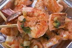 Salmon and prawn skewers with mint in aluminium dish Stock Photos