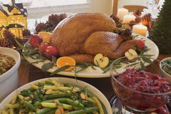 Roast turkey with all the trimmings on Christmas table (USA) Stock Photos