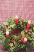 Advent wreath with four burning candles on checked cloth Stock Photos