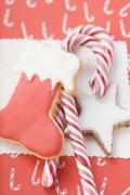 Cinnamon star, boot and candy canes (overhead view) Stock Photos