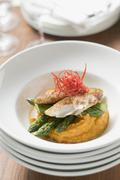 Pangasius fillet with asparagus and sweet potato puree Stock Photos