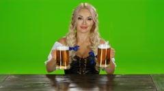 Bavarian girl takes on the table two glasses of beer nd shows thumbs. Green Stock Footage
