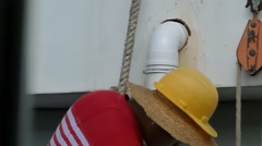 The construction worker is suspended on the wall Stock Footage