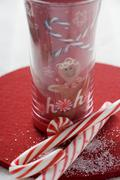 Sweets in front of festive glass Stock Photos