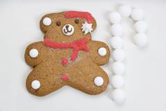 Christmas biscuit (teddy bear) and white sweets Stock Photos