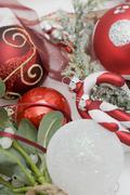 Christmas tree ornaments and mistletoe Stock Photos