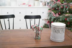 Candy canes & cookie tin in kitchen with Christmas decorations Stock Photos