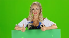 Sexy bavarian girl poiting to the green message card. Green screen Stock Footage