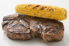 Grilled beef steak with corn on the cob Stock Photos
