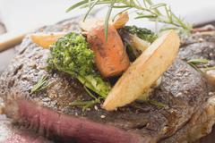 Sirloin steak with vegetables and rosemary Stock Photos