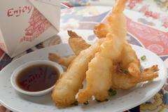Deep-fried prawns in batter with soy sauce to take away (Asia) Stock Photos