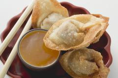 Deep-fried dim sum with sweet & sour sauce (Asia) Stock Photos