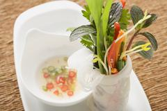 Rice paper roll filled with vegetables, noodles & herbs, chilli sauce Stock Photos