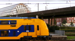 Dutch passenger train leaving train-station. Stock Footage
