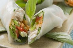 Rice paper rolls filled with chicken and vegetables (Asia) Stock Photos
