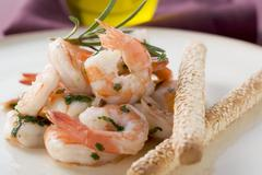 Fried prawns with rosemary and sesame grissini Stock Photos