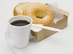 "Sesame bagel with crme fra""che in cardboard box, cup of coffee Stock Photos"