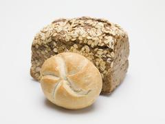 Wholemeal bread and bread roll Stock Photos