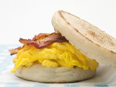 English muffin filled with bacon, scrambled egg & cheese (close-up) Stock Photos