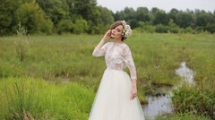 Beautiful model posing for the photographer outdoors Stock Footage