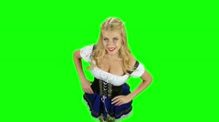 Woman in bavarian national costume is flirting. Green screen. Slow motion Stock Footage