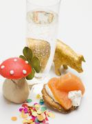 Glass of sparkling wine, salmon appetiser and lucky charms Stock Photos