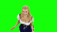 Girl in bavarian costume jumping and clapping for joy. Green screen. Slow motion Stock Footage