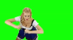 Girl in bavarian costume dancing isolated. Oktoberfest. Slow motion. Green Stock Footage