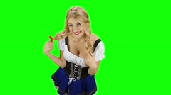 Girl in bavarian costume touches her hair and laughs. Green screen. Slow motion Stock Footage