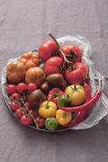 An assortment of tomatoes and chillies Stock Photos