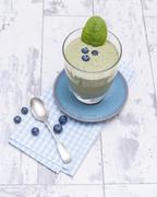 Melon shake with spinach and blueberries Stock Photos