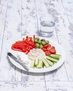 A selection of raw Mediterranean vegetables with a dip Stock Photos
