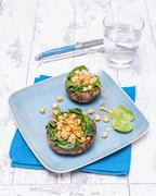 Portobello mushrooms filled with spinach and chickpeas Stock Photos