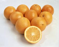 Whole navel oranges and one orange half Stock Photos