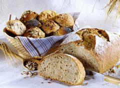 Granary bread and assorted rolls Stock Photos