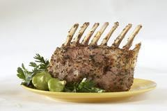 Roast rack of lamb Stock Photos