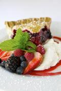 A Slice of Triple Berry Pie with Whipped Cream Stock Photos