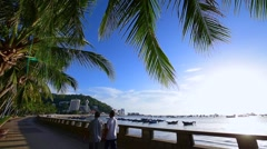 Tropical city enbankment. View of sea city shoot at wide angle lens Stock Footage